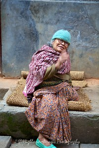 Old lady scolding me with a large smile for taking photograph in Bungamati.