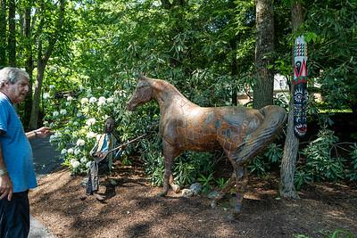 Dr. Cohen with sculptures