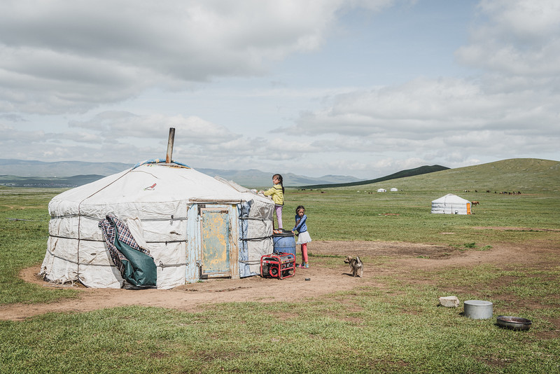 "Mongolia, Dzuunmod, 2019. The ""ger"" where a nomad family lives. The grassland steppe is home to generations of semi-nomadic herders. Since 1999, the nomads dropped from 50% to 25% of the total Mongolian population. Those remaining in the countryside make their living from herding, selling the animals' milk, meat and wool."