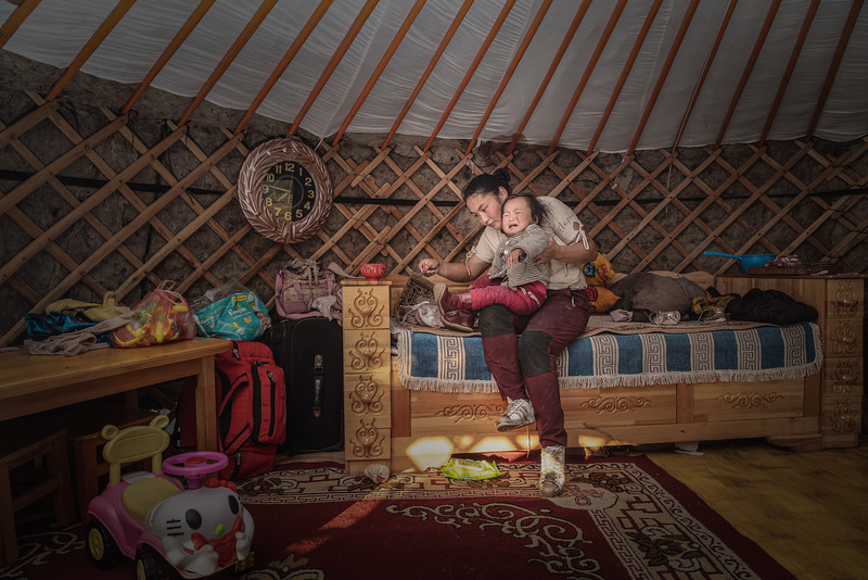 Mongolia, Ulan Bator, 2019. Narmandakh, 30, once lived on the steppe but since her family lost their herd she moved to one of Ulaanbataar's ger districts, where families live in tents on the outskirts of the city. They often lack running water, sanitation and access to local schools.