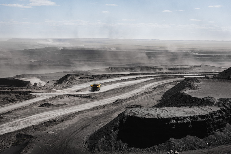 Mongolia, Tavan Tolgoi, 2019. Coal dust raised by the wind in the Tavan Tolgoi Mine. Tavan Tolgoi is located  in the Gobi Desert in the Ömnögovi province. It is one of the world's largest, untapped coking and thermal coal deposits. The nation is digging deep for a wealth previously unknown. The arid landscape dotted with camels has given way to heavy machinery and open-pit mines like this one.
