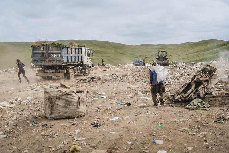 Mongolia, Ulan Bator, 2019. Scavengers searching for valuable materials in a landfill in the outskirts of Mongolia's capital, Ulan Bator. This landfill becomes an option for environmental migrants arriving in Ulan Bator from the countryside, that try to search items to sell and make some money to survive.