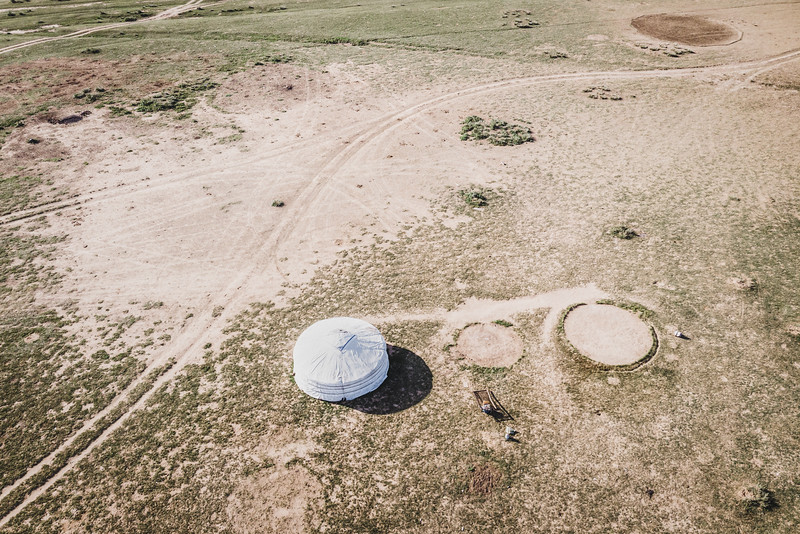 Mongolia, Arhangaj, 2019. An empty space left by the departure of a nomad family. Not everyone has weathered dzuds as well. Mongolians who lost all their livestock — all their wealth — to dzuds have had little choice but to give up herding and move. Since 1999, the overall proportion of Mongolian households with herding as their primary economic means has decreased from 50% to 25%.