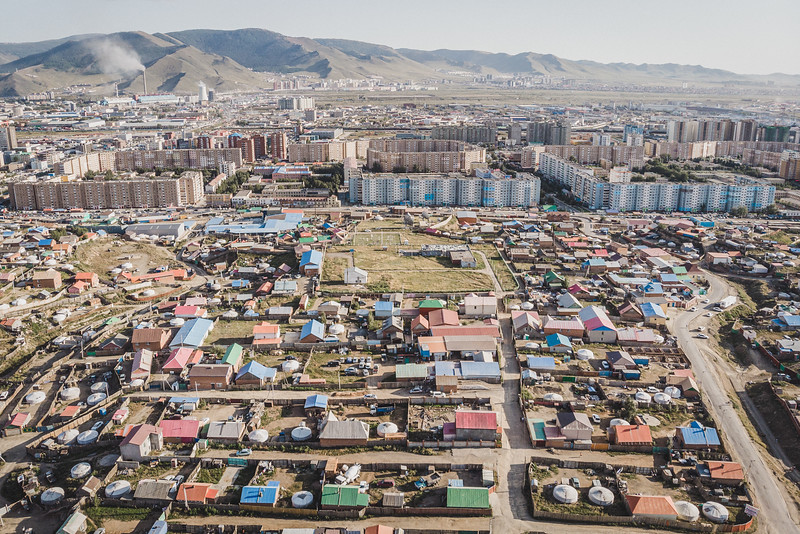 Mongolia, Ulan Bator, 2019. An aerial view of Ulan Bator ger district on the outskirts of the city. This area has been expanding as many people moved from rural areas in search of a better life. The rapid growth of the ger areas has created several challenges for the infrastructures: there is no running water or electricity, and other crucial social services. The coal-fired power plants with its particle emission contributes to make Ulan Bator one of the most polluted cities in the world.