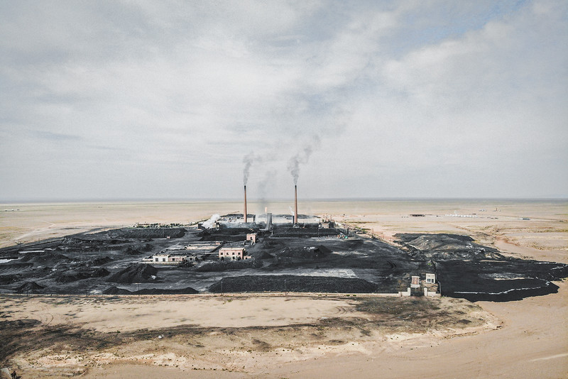 Mongolia, Gobi, 2019. In the Gobi Desert in southern Mongolia, the herding is giving way to the mining industry. While the land is peppered with livestock, the rock below is rich with coal, copper and gold. Mining activities have been associated with serious adverse environmental impacts, including soil and water pollution, shortage of water and droughtness. The Gobi landscape is changing as the industry grows.