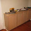North wall East end contain the actual dressing portion of this room. Base cabinets built with new electrical outlet on west end as well as one within for running watch winders, etc.