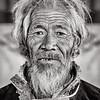 Tibetan man at Ngor Monastery restaurant near Shigatse