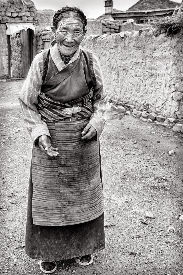 Tibetan woman outside her home near Shigatse