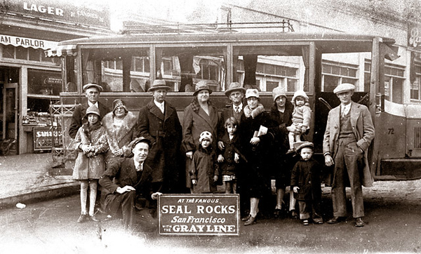 """Raleigh and Iola Gray and Harold and Winona Gray with their children during a visit to San Francisco, California and a tour on the """"Gray Line"""" in about 1925."""