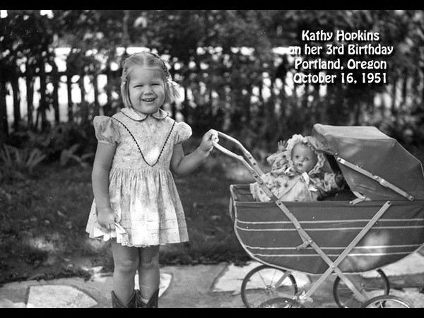 Kathy Hopkins with her new doll buggy in the back yard at 4285 S.E. Stark Street, Portland, Oregon on her birthday, 16 October 1951.