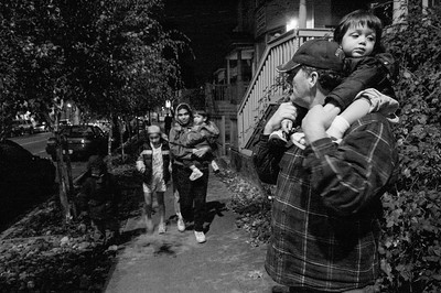 Angela and Leonard DeClue, and their children trudge across Seattle's Capitol Hill on a winter evening en route to a family housing shelter.