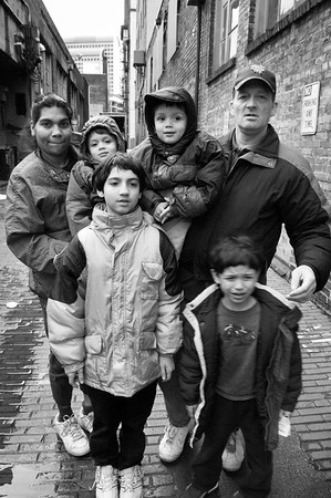The  homeless family of Leonard and Angela DeClue  and their four boys Jeremiah, 9, Alexander 5 and twins Sean and Darien, 2, (photographed in an alley in downtown Seattle)spend their days at the Family and Adult Service Center in Seattle. At 8:20 each evening the family must board a city bus for a 40 minute ride to a church which provides them a place to sleep for the night. At 6:20 each morning the family is awakened and by 6:40 they are on a bus heading back to the FASC facility downtown. From there the older children depart on another one hour bus ride to school while their parents deal with the small children and the sometimes daunting bureaucracy faced by the homeless.