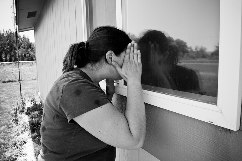 A homeless woman in Yakima Washington looks inside her former home, from which she and her two daughters were evicted after her husband lost all their money gambling.