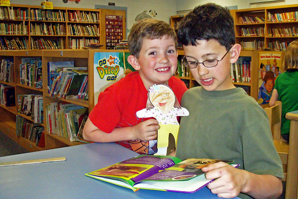 "Tuesday, March 17 - Ethan and Aaron attend North Lee Elementary.  Each Tuesday and Thursday after school, the library remains open for a few hours for Family Reading.  Their school has an Accelerated Reader program in which the students earn points by testing on the books they have read.  Right now, Ethan is the top point earner in the school.  That is so COOL! Today, Cindy read ""Flat Stanley"" while we were there."