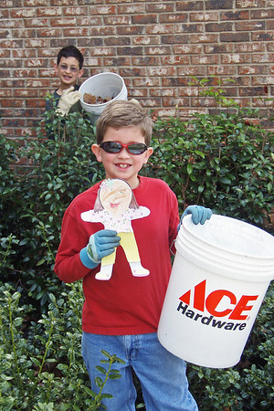 Tuesday, March 24 - Today, Ethan and Aaron had chores to do.  They had to get all of the leaves from out of the shrubs around the house.  They were not very happy about that.  But it didn't take them too long, once they stopped complaining.