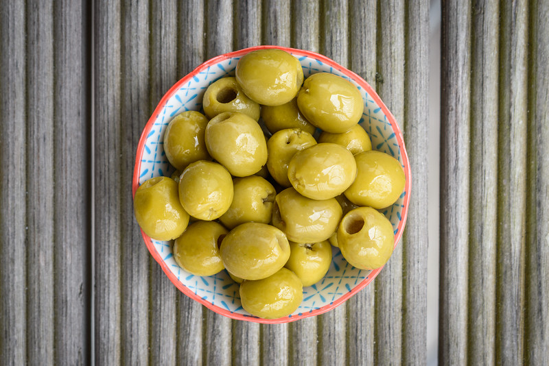 A small bowl of green olives