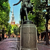 Paul Revere statue with his hand extending to the Old North Church in the background. That tower is where the Revere ordered Newman to hang the lights as an announcement ( if by land, 2 if by water).