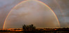 This is two images stitched together to capture the entire rainbow.