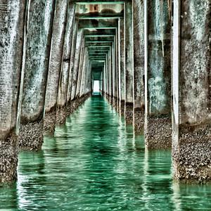 Underneath Naples Pier at noon