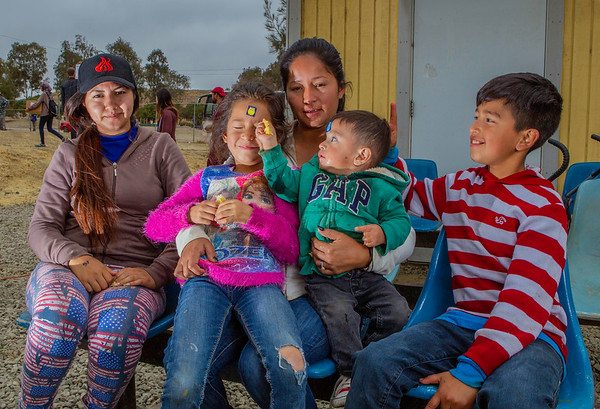 "John Chaides<br /> Estefany Lopez (far left), Briana Quesada (6), Naomi Estrada (middle), Thomas Estrada (1), and William Quesada (10) sit and pose for a picture at the ""El Dumpe"" Clinic by Healing Hearts Across Borders in Tijuana, Mexico on Saturday, May 19, 2018. They are a local family and visit the clinic regularly."