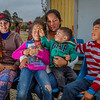 "John Chaides / Courier<br /> Estefany Lopez (far left), Briana Quesada (6), Naomi Estrada (middle), Thomas Estrada (1), and William Quesada (10) sit and pose for a picture at the ""El Dumpe"" Clinic by Healing Hearts Across Borders in Tijuana, Mexico on Saturday, May 19, 2018. They are a local family and visit the clinic regularly."
