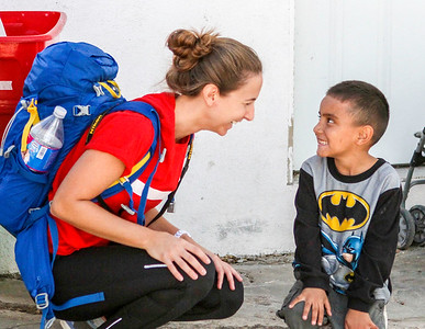 John Chaides Simone Yassear, from San Deigo, laughs with a child at the Colonia Grupo Clinic by Healing Hearts Across Borders in Tijuana, Mexico on Friday, November 10, 2017.