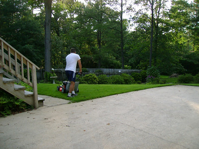 Michael cutting the grass.