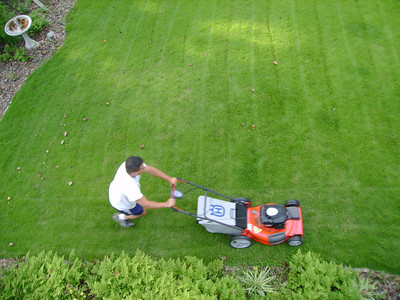 Michael cutting the grass - 2007.