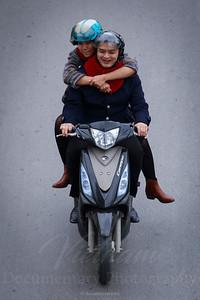 Hugging on motorbike