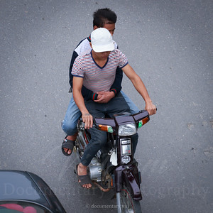 Hugging on motorbike