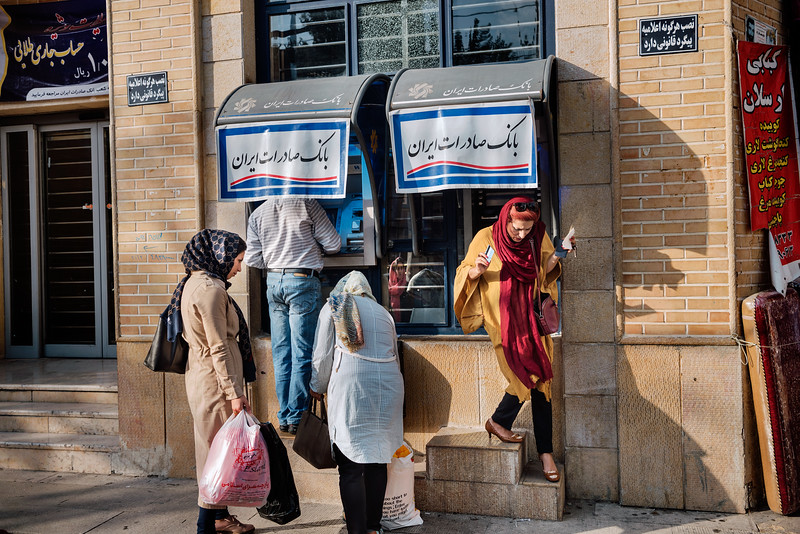 August  19, 2017 – Shiraz, Iran. Women who take money at a local ATM machine. Due to sanctions against Iran, international cards are not recognized. © Simone Tramonte
