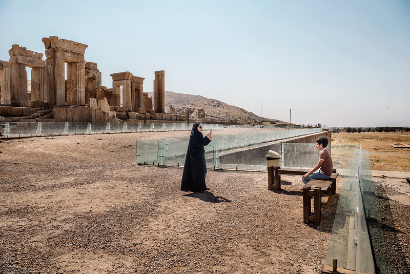 August 19, 2017 – Persepolis, Iran. An Iranian woman photographs her son with her smartphone at the Persepolis archaeological site. Despite the slow mobile Internet connections, Iran has seen a significant increase in smartphones. Selfie and Social Network have become a real craze. More than 60% of the electronic market in Iran is supplied by foreign vendors. Among all product groups in the market, telecommunication products are mostly imported from overseas because of their high technology. Legally imported cell phones in 2016 were worth about $ 250 m, which includes a share of only 10% in the vast mobile phone market of Iran. The other 90% are imported illegally. The growth of the young population in Iran with the increasing need for telecommunications products, including smart mobile phones, is the main driver of this market. © Simone Tramonte