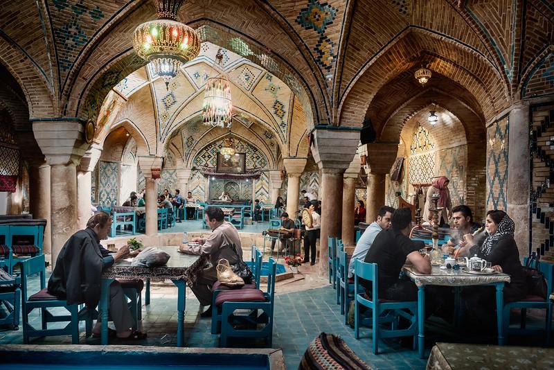 August 20, 2017 – Kerman, Iran. An Iranian woman smokes a water pipe in a restaurant in an old hammam in ganjali bazaar. © Simone Tramonte