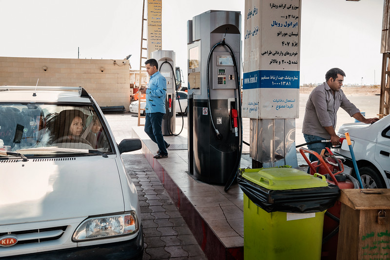 August  25, 2017 – Qom, Iran. A woman fills her car's tank at a service station in Qom. Petrol prices, which are regulated by the government, have risen sharply in the last years. © Simone Tramonte