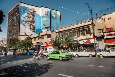 August 26, 2017 – Teheran, Iran. In the streets of downtown, a wall painting shows an army hero. The city of Tehran is still full of some propaganda wall paintings recalling the Iraq-Iran War, army heroes and anti-american and anti-western themes. © Simone Tramonte