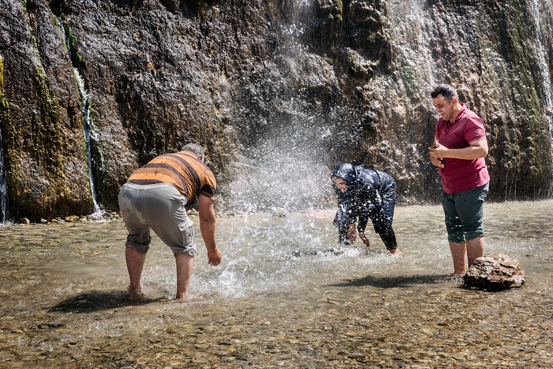 August 17, 2017 – Semiron, Iran. A family jokes and plays during a vacation at the Semiron waterfalls. © Simone Tramonte