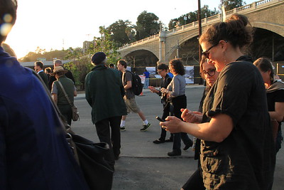 Group of attendants explore the mobile website on guided walk.