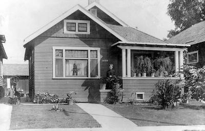 1915, Woman in Front of Home