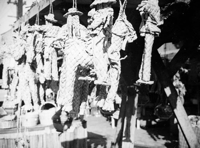 Woven Dolls Hang from the eaves of this vendor stand on Olvera St.