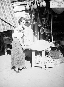 1937, Olvera St., Woman at Vendor Stand