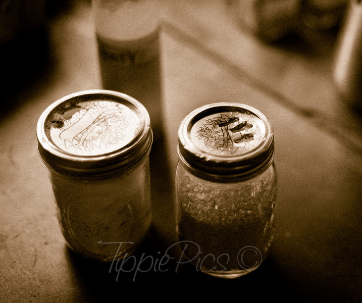 "Day 32 Simplicity  I have to say, when I walked up to the table at <a href=""http://www.camp4coffee.com/"">Camp 4 Coffee</a>, I was searching for the sugar and couldn't find it. Once my eyes settled on these little jars, I had to chuckle. I had overlooked the obvious.  And then I was taken with the simplicity of it. I don't like how much we tend to go out and buy the newest, coolest gadget. Something neat and fun just because it's neat and fun. Instead, with as much over consumption as we have, it's nice to see when people simplify things and find creative and fun ways to reuse what they have. I think I have something to learn from them.  *On a side note, this photo is actually from the 12th. I wasn't happy with any of the photos I took on the 14th so I cheated. It's my project, right?"