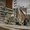 Vince Steffen of Empire Wrecking prepares to demolish the final corner of the B. Forman building.