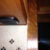 starboard rear speaker for dash radio under galley cabinet.