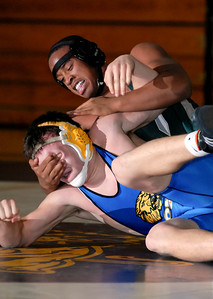 Staff photo by Shannon Lee Zirkle Tuscarora's Carrington Jones grapples with Walkersville's Will Scarf in a 189-pound match, Wednesday night at Walkersville.  Scarf won the match 10-7.