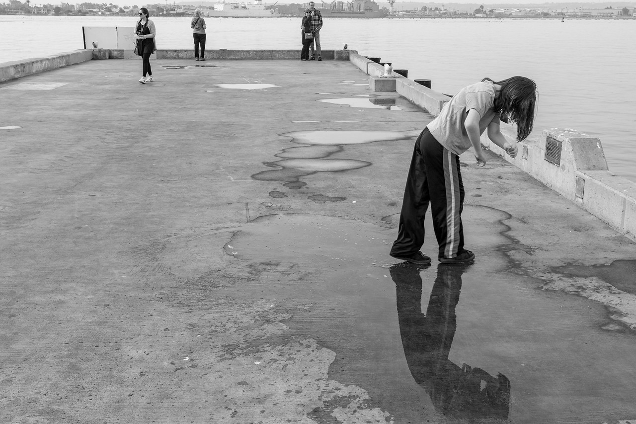 Ian Playing in Puddles on the Fish Market Pier