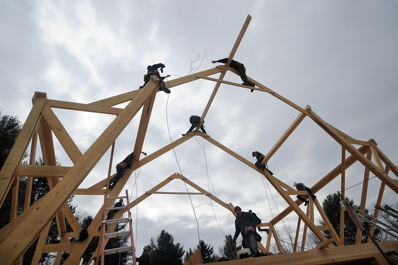 CONWAY (March 8, 2014) Barn raising at Natural Roots in Conway. Based on an Amish design dozens of volunteers worked all day to build a livestock barn. Photo by Beth Reynolds