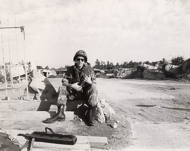 Me with my invisable gun at the gate of the destroyed Marine barracks 1/13/84.