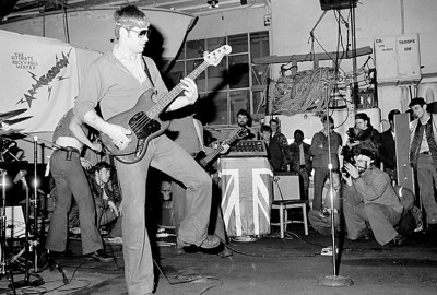 World famous rock n' roll band Armageddon. Mike Hines on bass, Flecther Reynolds on guitar, Tim Sullivan on drums. In the photo you can also see Pepe (taking picture bottom right) Terry (behind Pepe) and Steve Marcus (middle background)