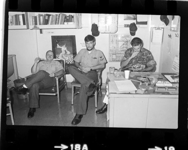 Left to right. Parker Davis, Carmine (Pepe) DeGracia and unknown Marine in the Photo Lab.