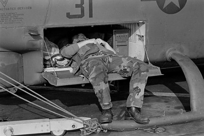 Marine sleeping inside a Cobra Gunship